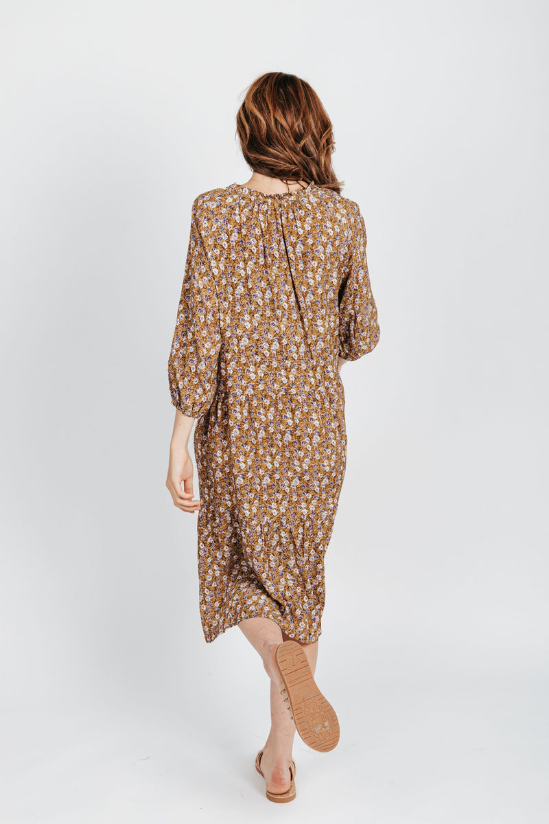 The Hailey Ditsy Floral Dress in Mustard, studio shoot; back view