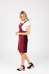 The Dottin Corduroy Jumper Dress in Burgundy, studio shoot; side view