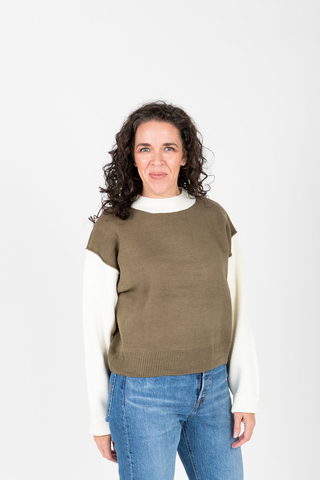 The Marini Contrast Sleeve Knit in Olive, studio shoot; front view
