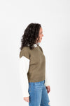 The Marini Contrast Sleeve Knit in Olive, studio shoot; side view
