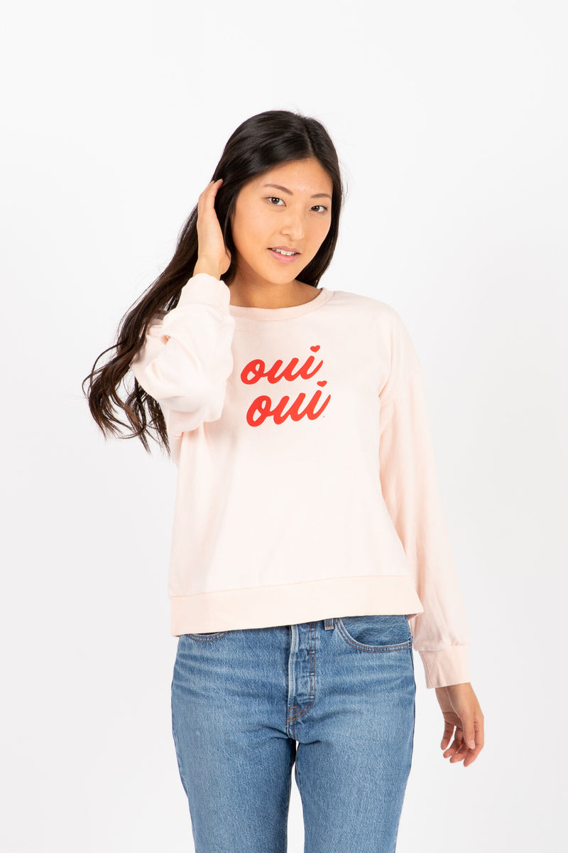 The Oui Oui Crew Neck Sweatshirt in Blush, studio shoot; front view