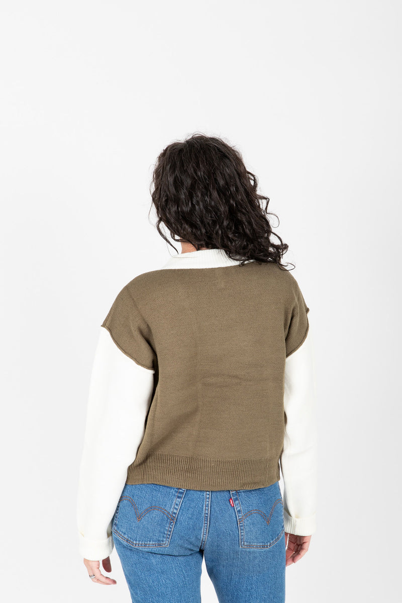 The Marini Contrast Sleeve Knit in Olive, studio shoot; back view