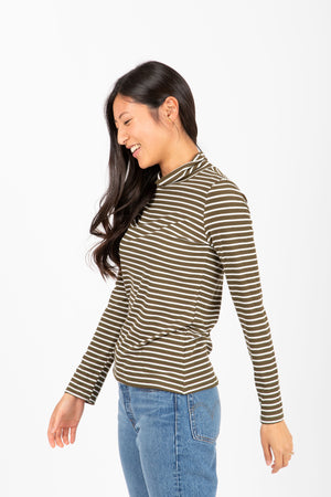 The Haley Striped Turtleneck in Olive, studio shoot; side view