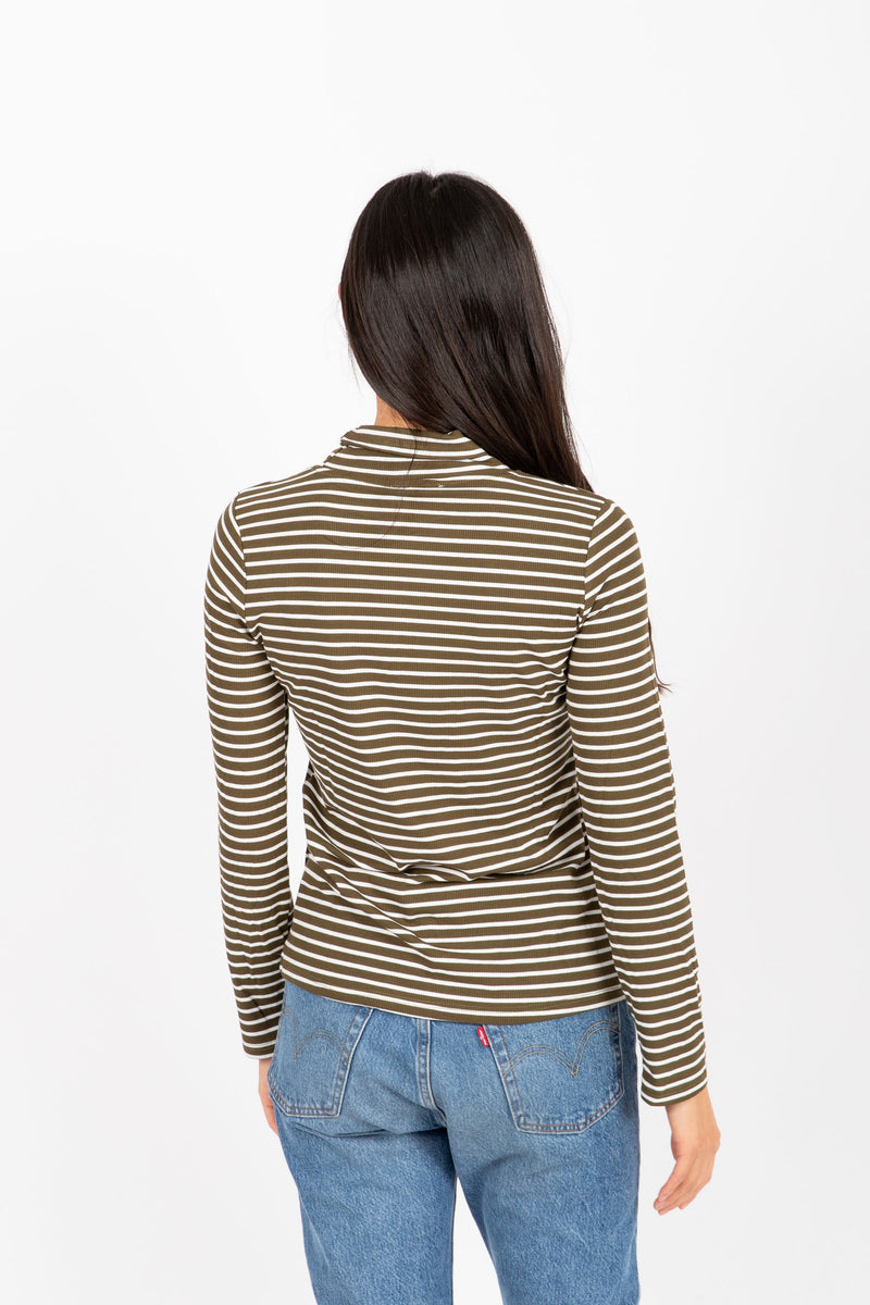 The Haley Striped Turtleneck in Olive, studio shoot; back view
