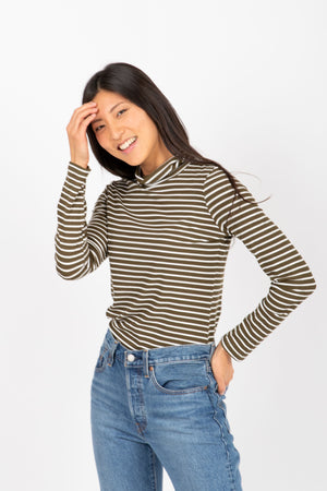 The Haley Striped Turtleneck in Olive, studio shoot; front view