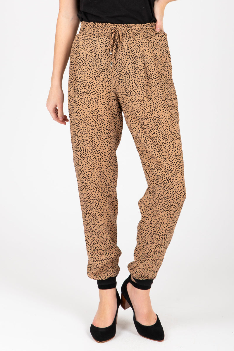 The Leopard Print Jogger Pants in Camel, studio shoot; front view