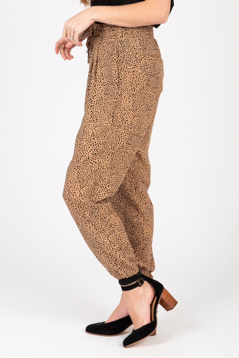 The Leopard Print Jogger Pants in Camel, studio shoot; side view
