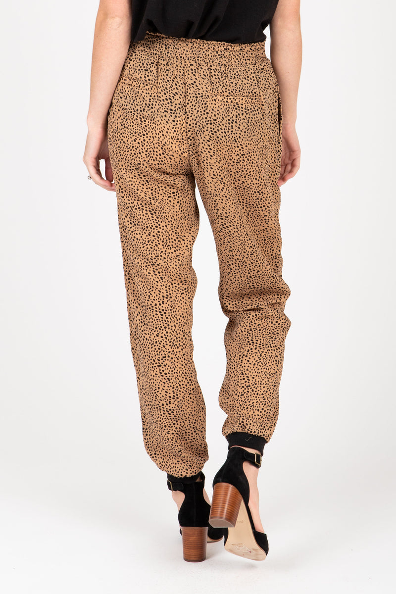 The Leopard Print Jogger Pants in Camel, studio shoot; back view