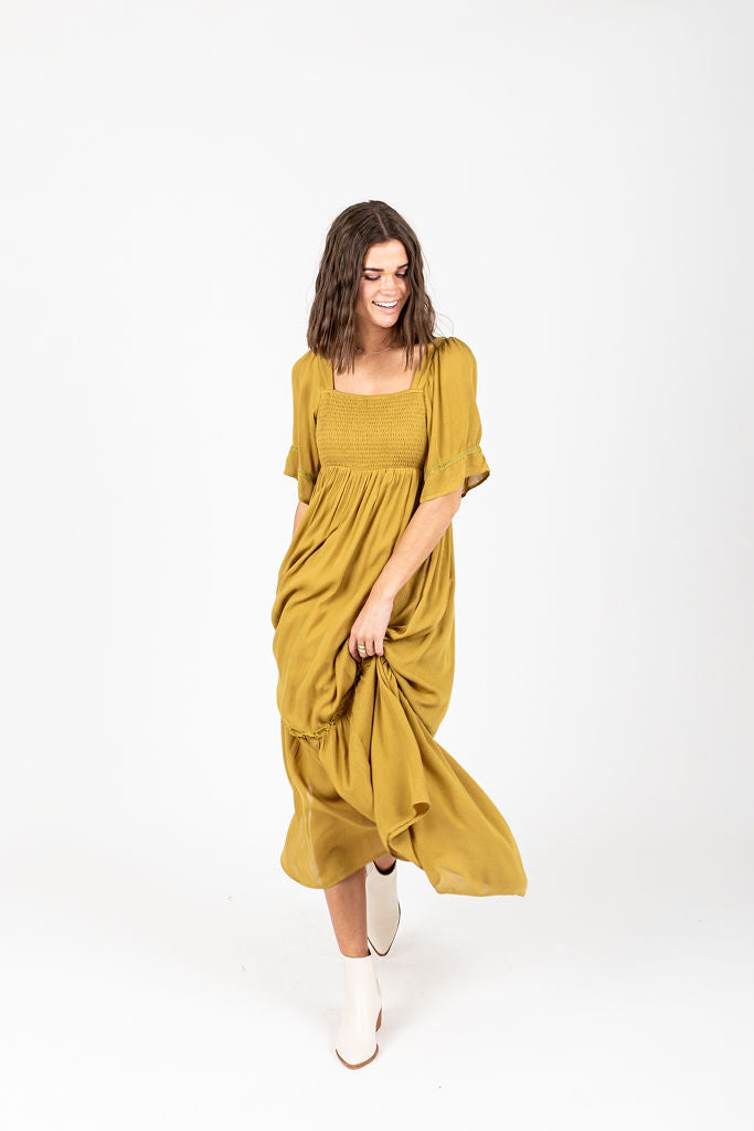 The Disher Smocked Maxi Dress in Chartruese, studio shoot; front view