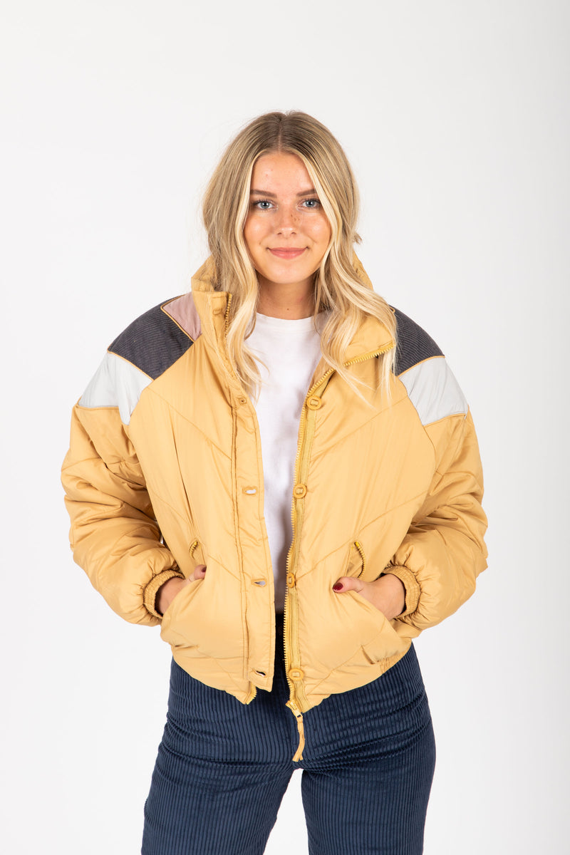 The Babita Padded Bomber Jacket in Mustard, studio shoot; front view