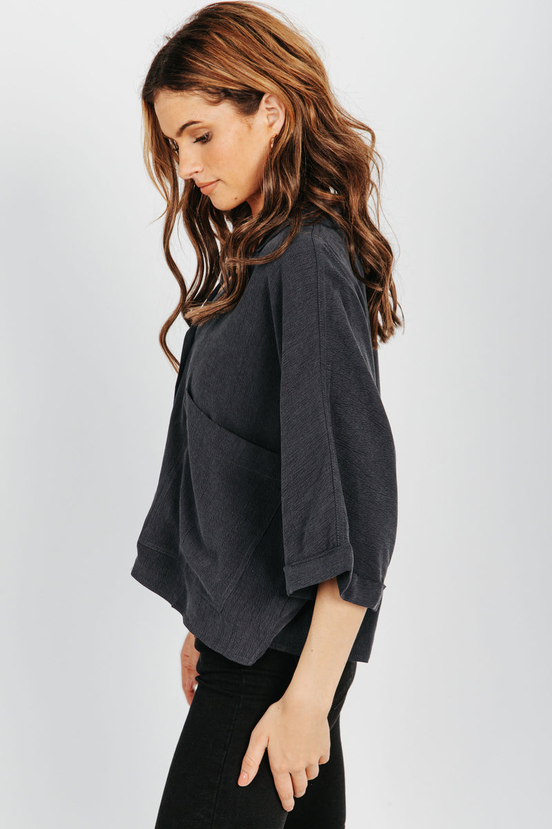 The Camryn Pocket Blouse in Charcoal, studio shoot; side view