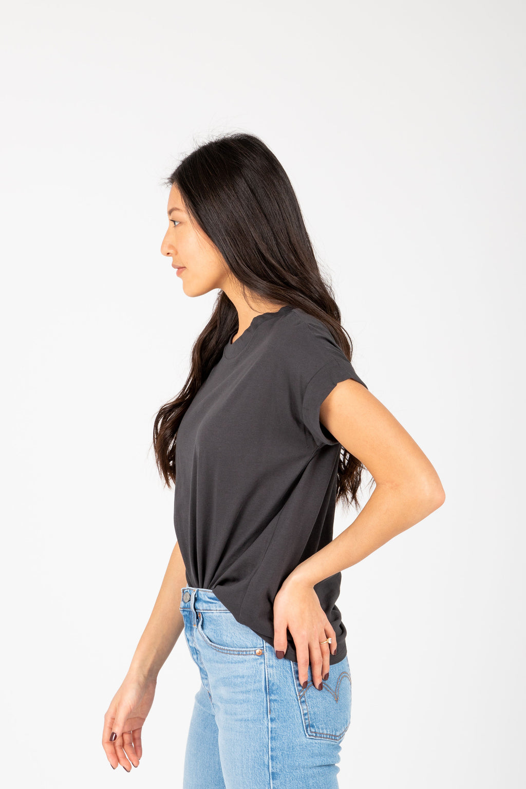 The Allegro Cuff Basic Tee in Faded Black, studio shoot; side view