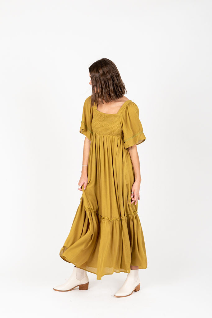 The Disher Smocked Maxi Dress in Chartruese, studio shoot; side view