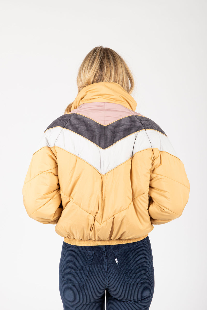 The Babita Padded Bomber Jacket in Mustard, studio shoot; back view
