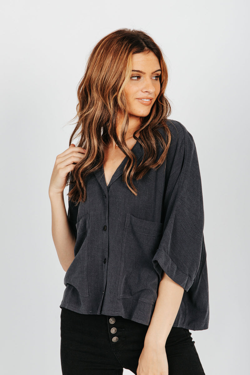 The Camryn Pocket Blouse in Charcoal, studio shoot; front view