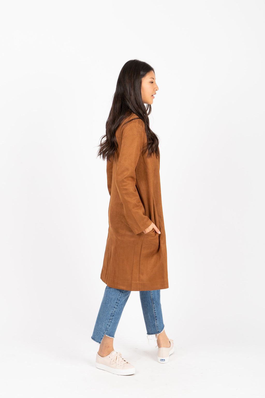 The Whalen Suede Cardigan in Saddle, studio shoot; side view