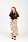 The Carrington Floral Pleated Skirt in Natural, studio shoot; front view