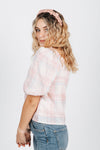 The Pauline Gingham Blouse in Pink Plaid, studio shoot; side view
