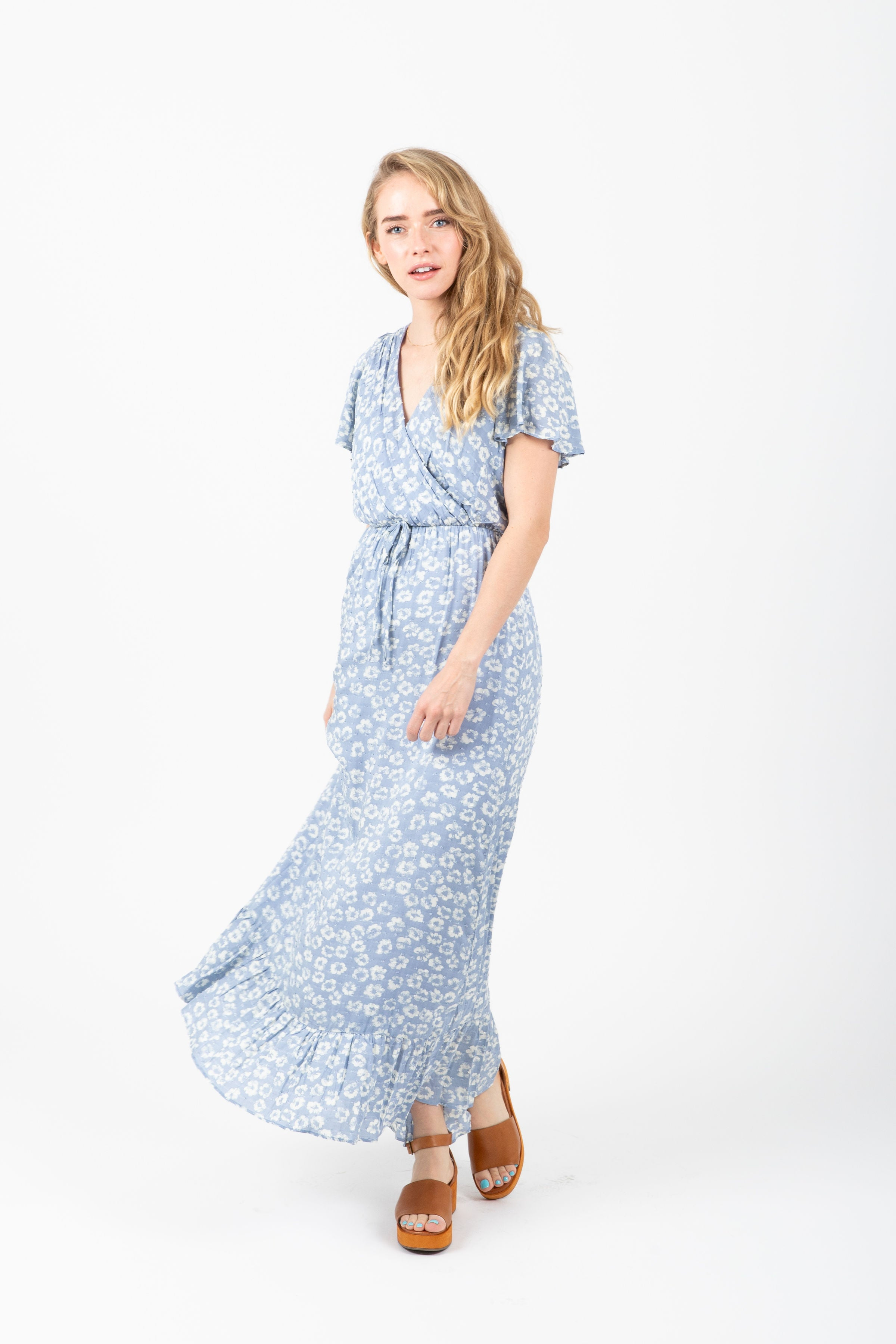 The Soar Floral Ruffle Maxi Dress in Blue