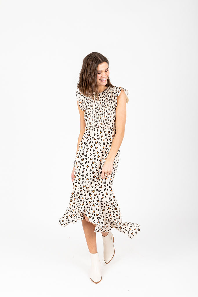 The Kylen Smocked Ruffle Dress in Animal Print