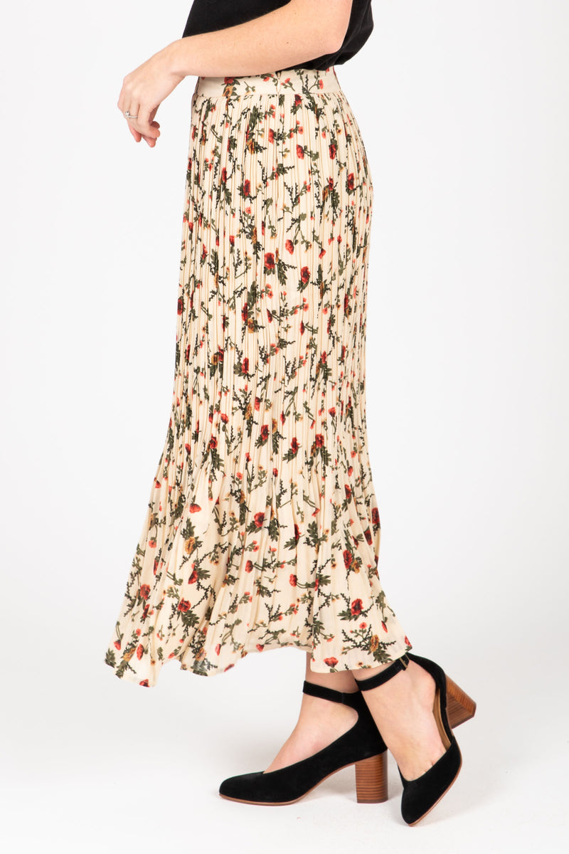 The Carrington Floral Pleated Skirt in Natural, studio shoot; side view