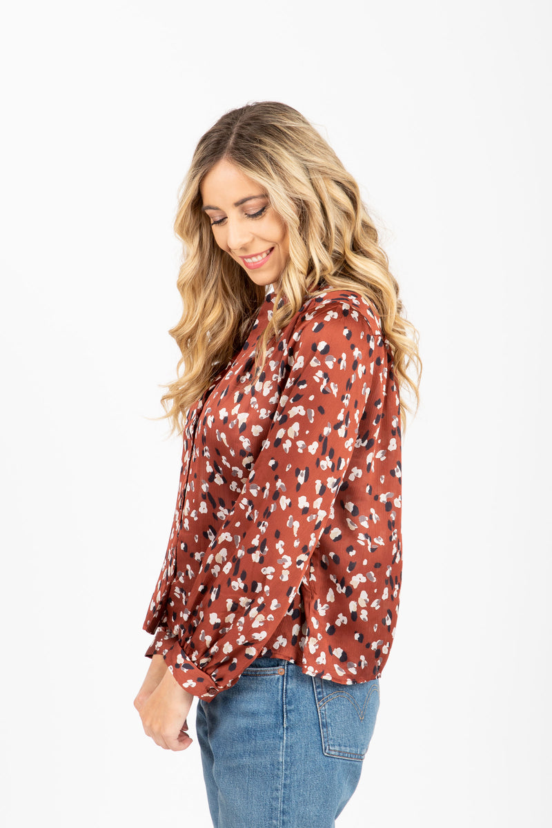 The Faye Floral Button Blouse in Mocha, studio shoot; side view