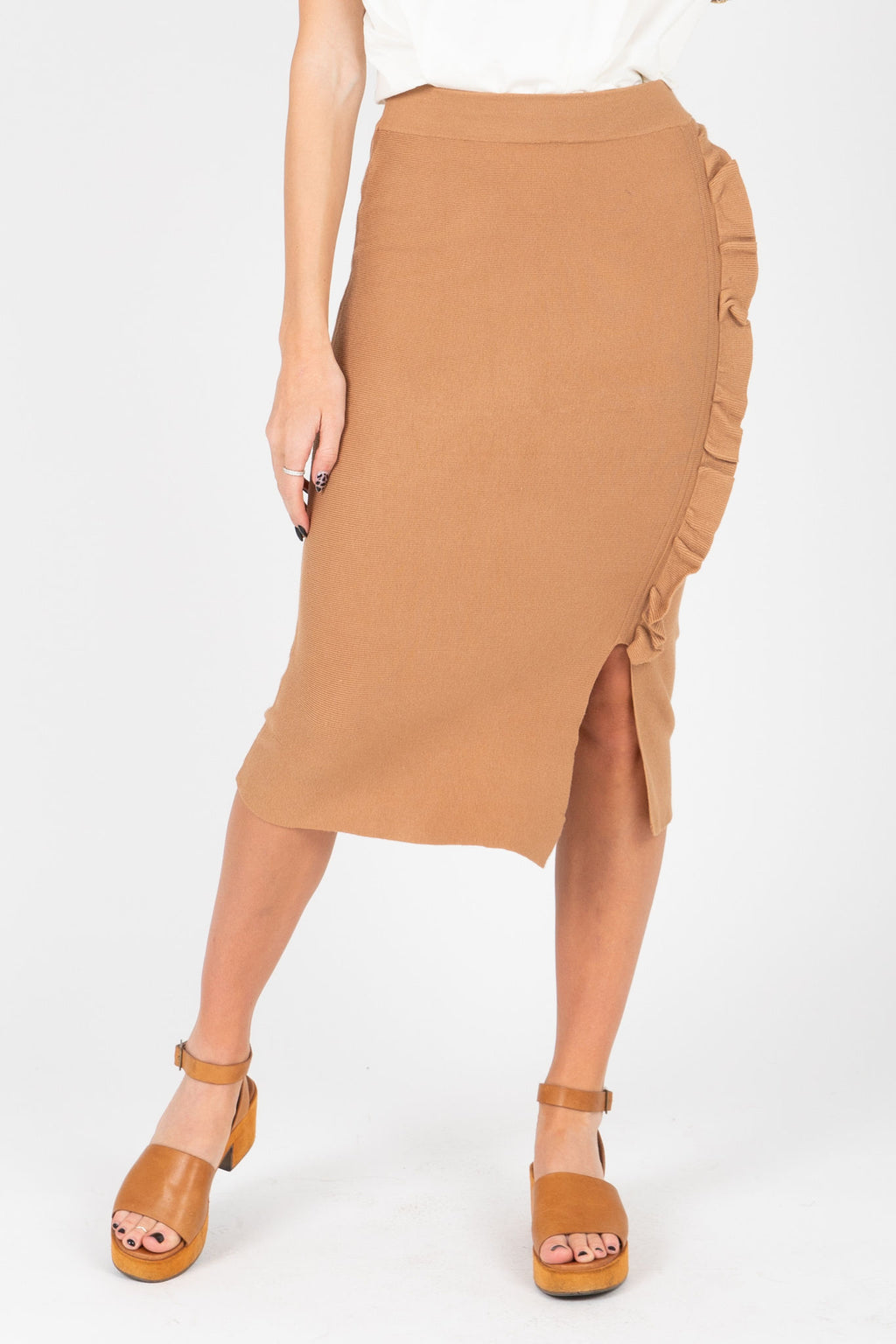 The Cyrus Ruffle Detail Knit Skirt in Tan, studio shoot; front view