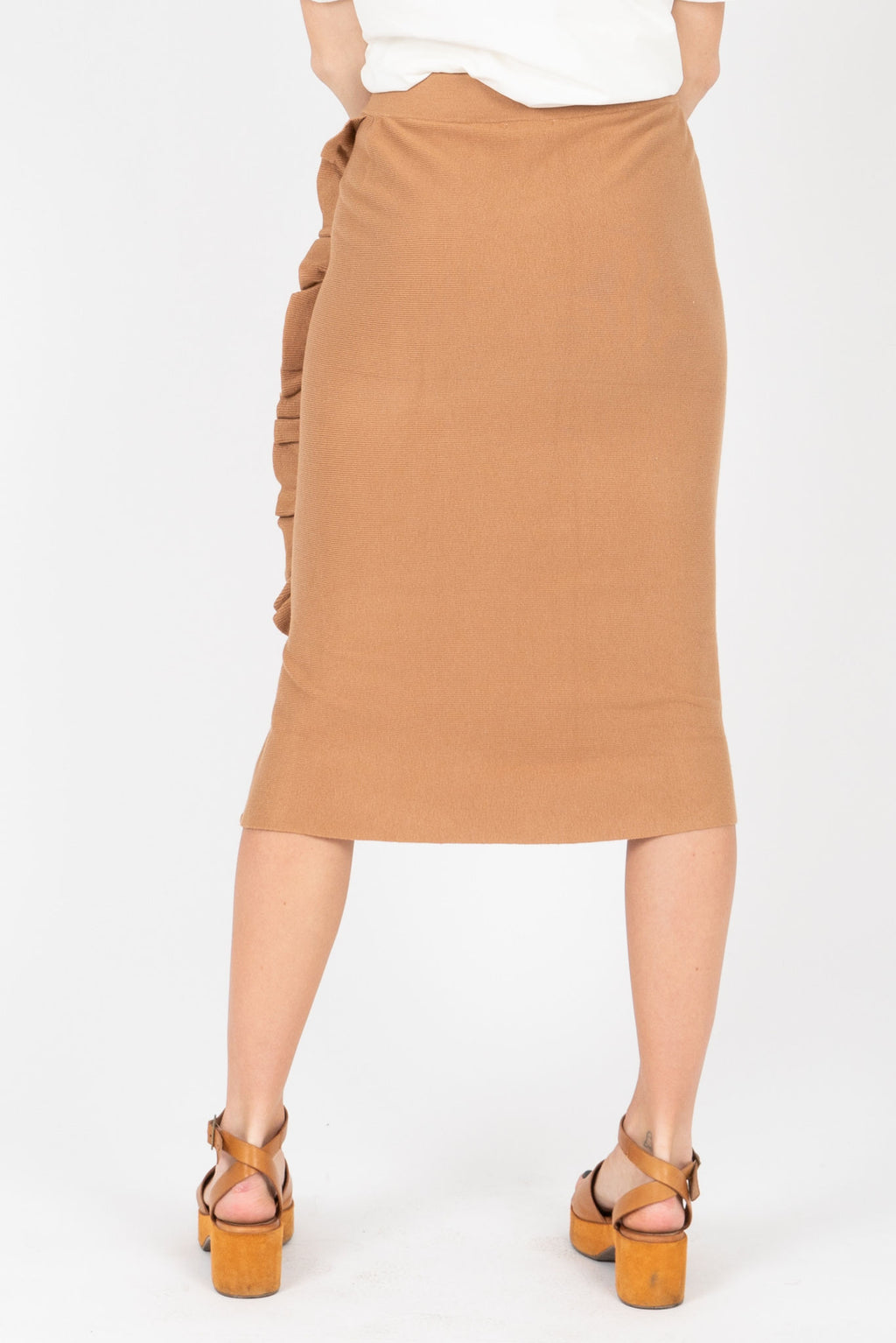The Cyrus Ruffle Detail Knit Skirt in Tan, studio shoot; back view