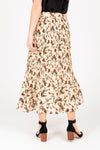 The Carrington Floral Pleated Skirt in Natural, studio shoot; back view