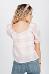 The Pauline Gingham Blouse in Pink Plaid, studio shoot; back view