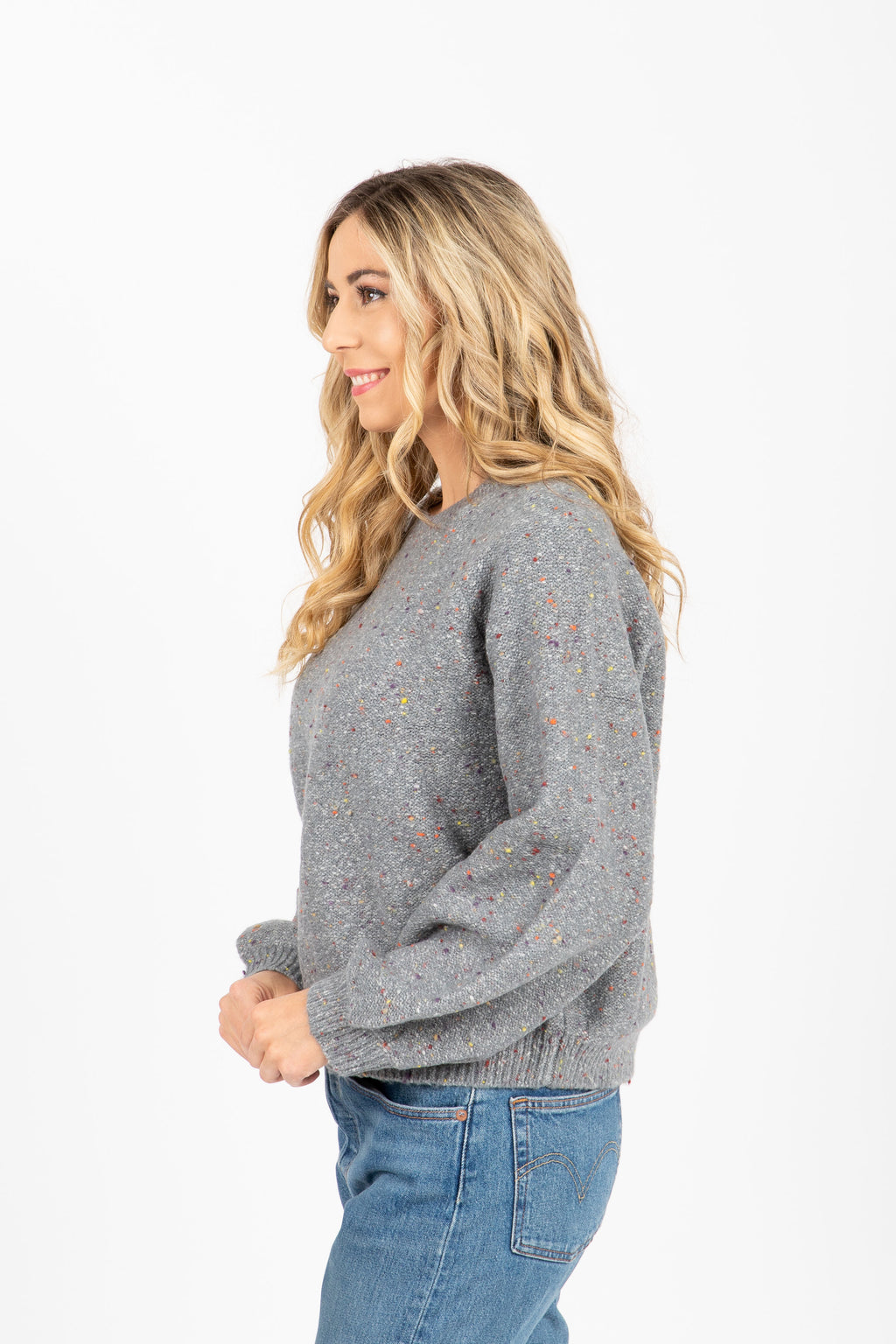 The Remy Speckled Sweater in Grey, studio shoot; side view