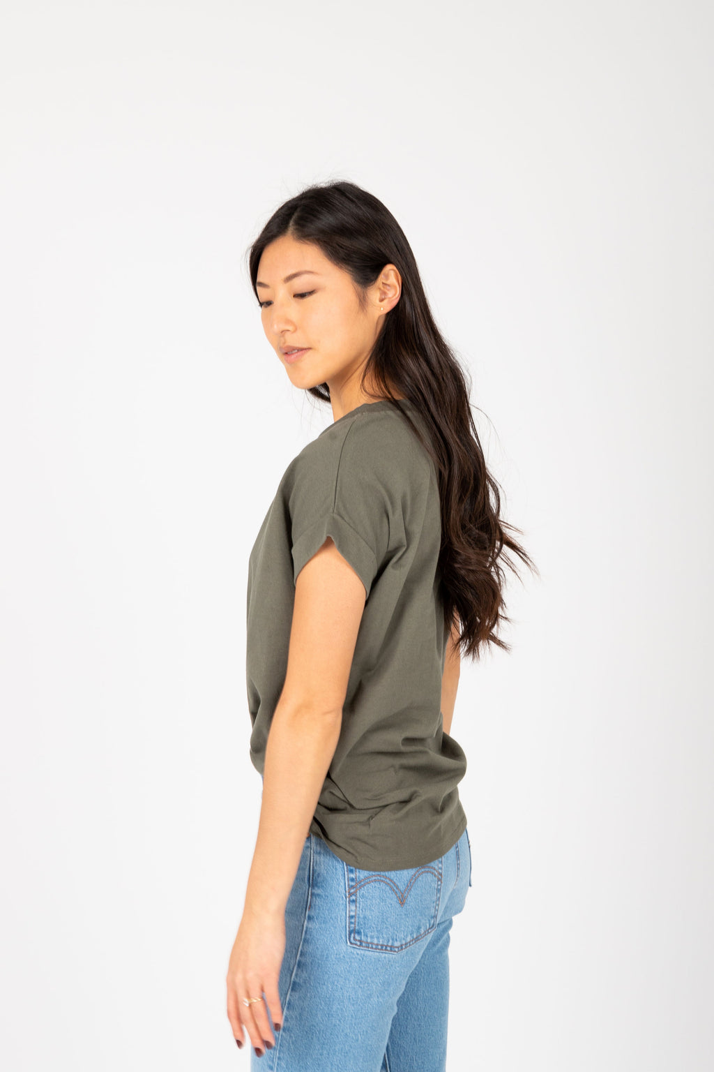 The Allegro Cuff Basic Tee in Olive, studio shoot; side view
