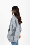 The Darby Crochet Knit Cardigan in Steel Blue, studio shoot; side view