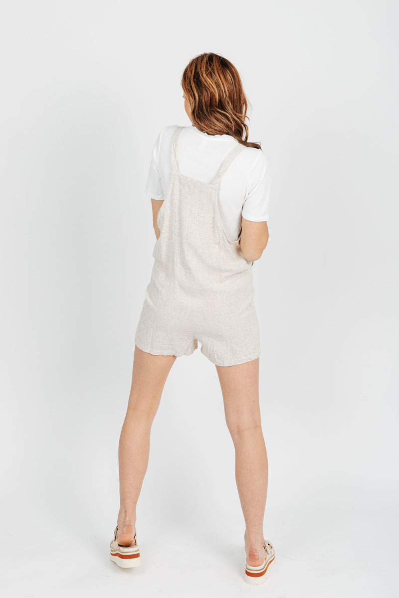 The Tristan Overall Short in Oatmeal, studio shoot; back view