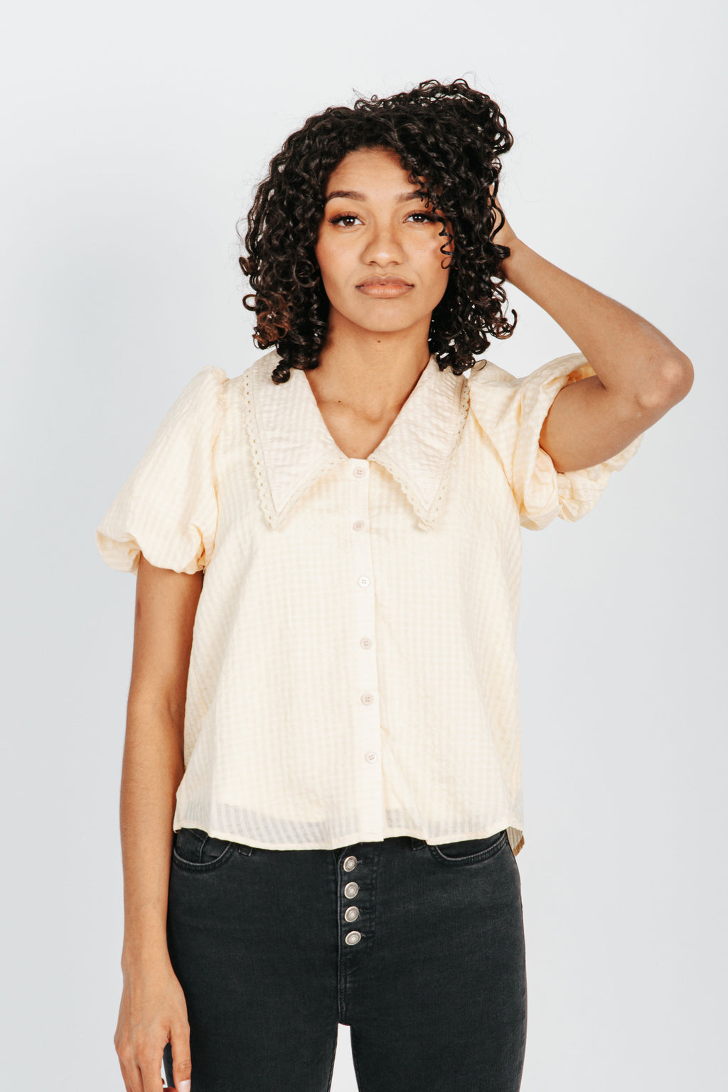 The Maria Lace Collared Blouse in Cream, studio shoot; front view