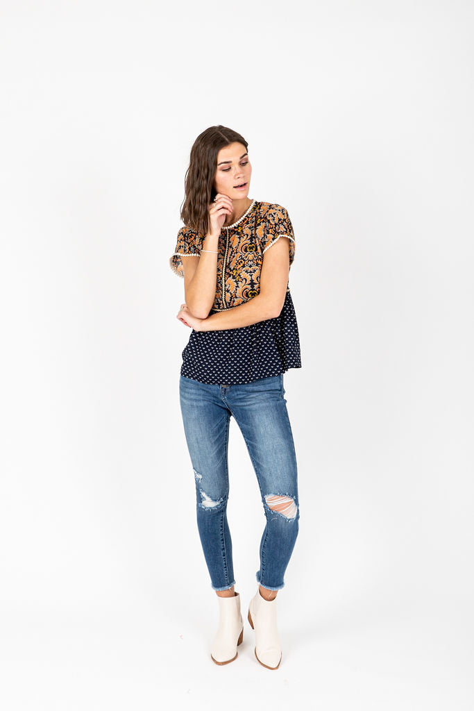 The Braff Pom Detail Blouse in Navy, studio shoot; front view