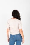 The Blair Cozy Slit Knit in Blush, studio shoot; back view