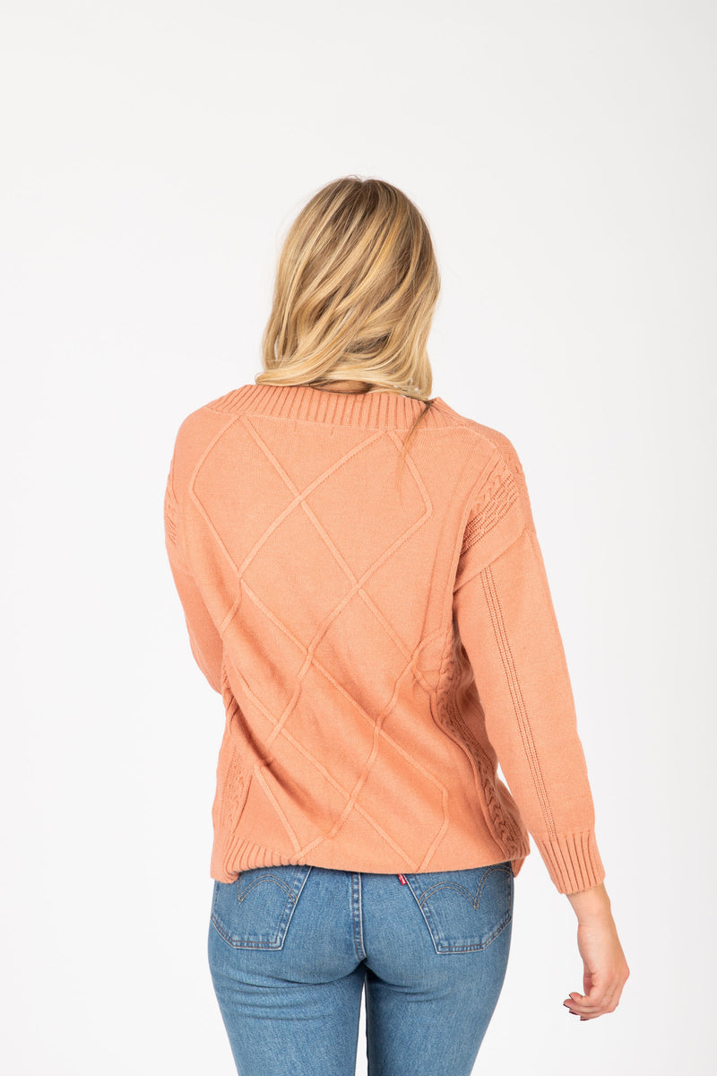 The Gertrude Diamond Sweater in Peach, studio shoot; back view
