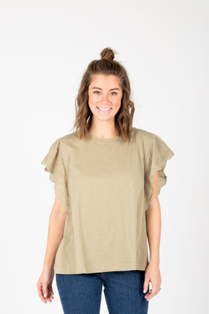 The Elina Eyelet Ruffle Blouse in Faded Olive, studio shoot; front view