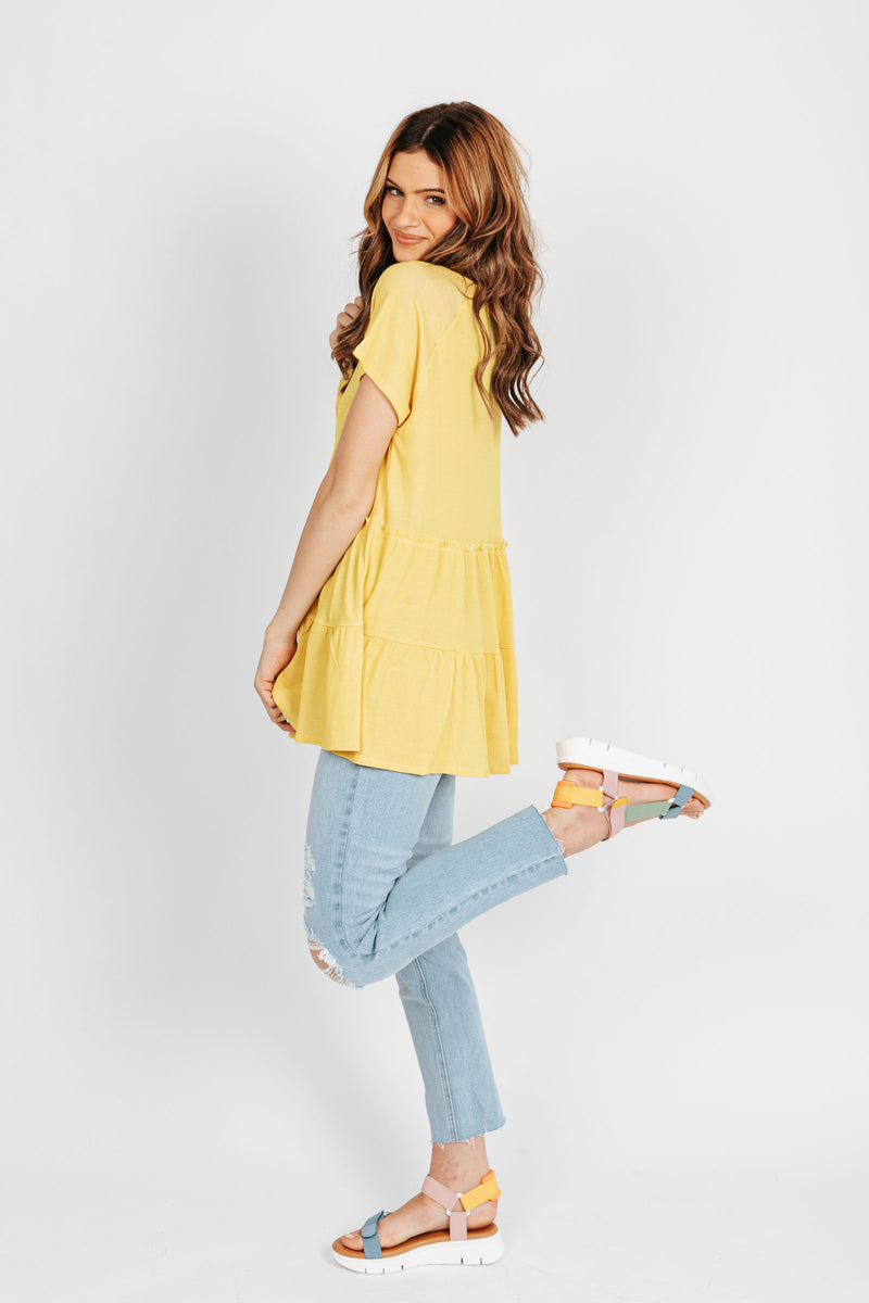 The Holmes Tiered Blouse in Yellow, studio shoot; side view