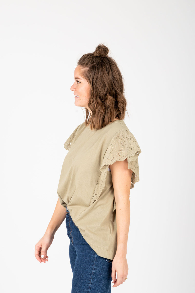 The Elina Eyelet Ruffle Blouse in Faded Olive, studio shoot; side view