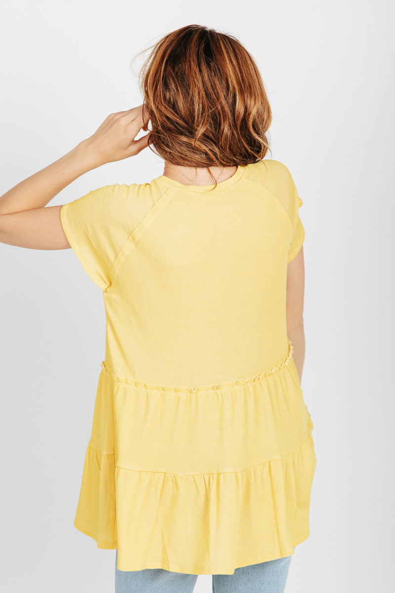 The Holmes Tiered Blouse in Yellow, studio shoot; back view