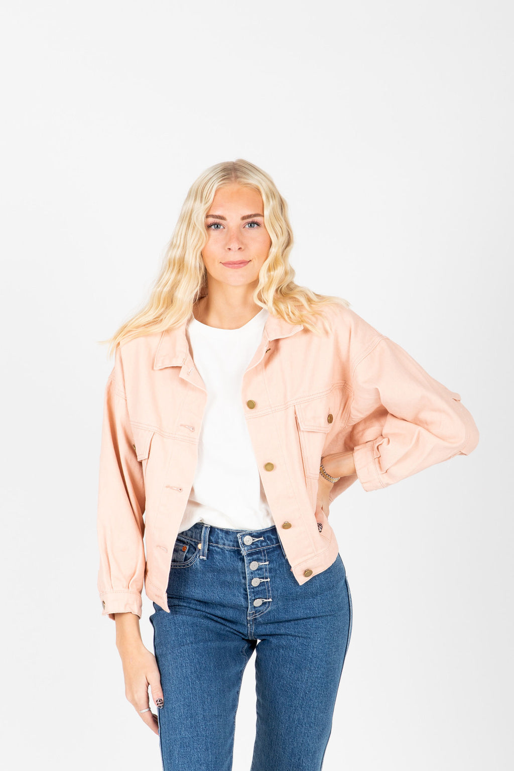 The Mitte Cropped Denim Jacket in Blush, studio shoot; front view