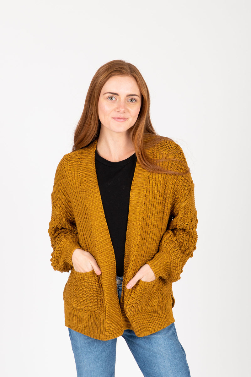The Clarise Open Pocket Cardigan in Mustard, studio shoot; front view