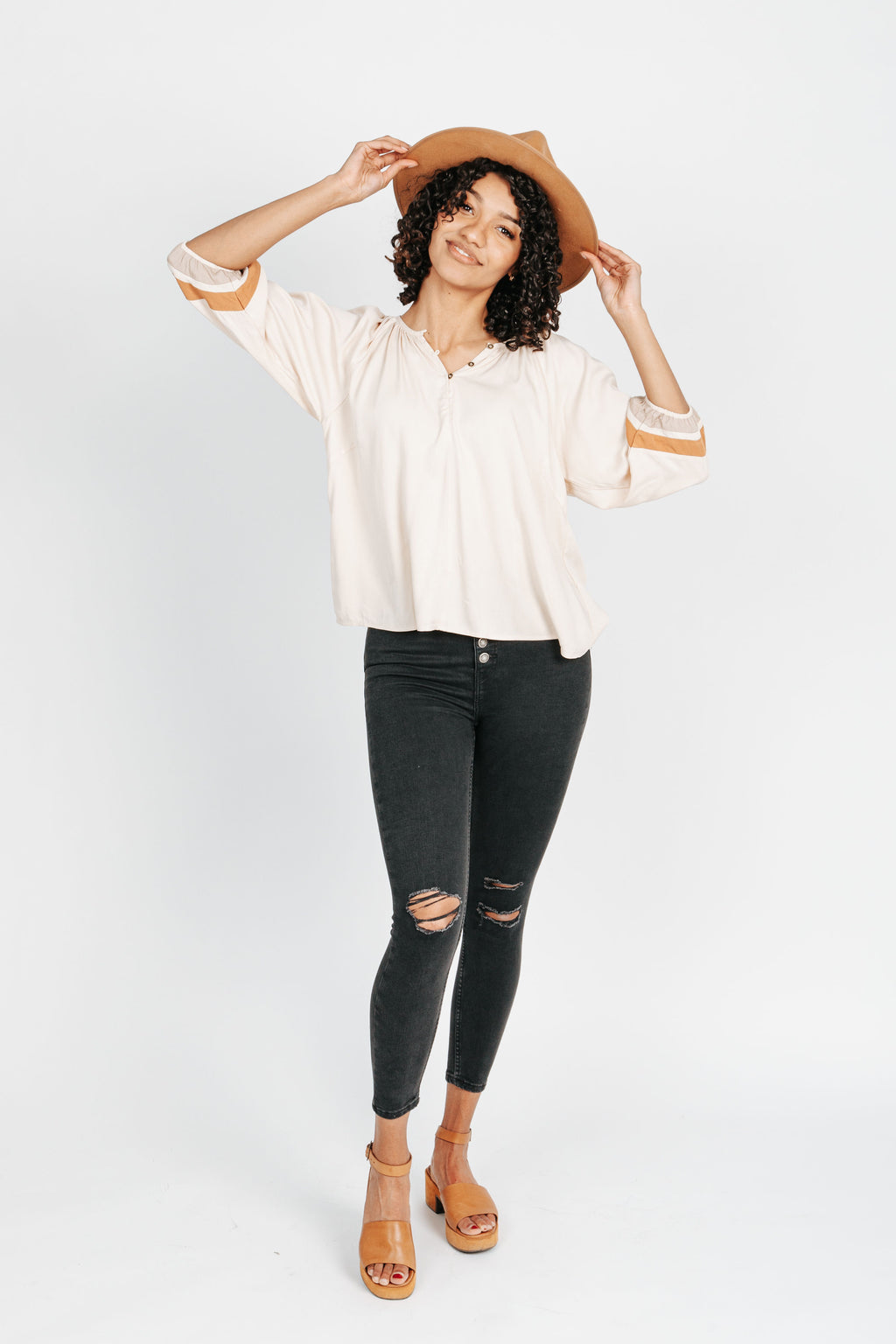 The Caleb Button Up Blouse in Cream, studio shoot; front view
