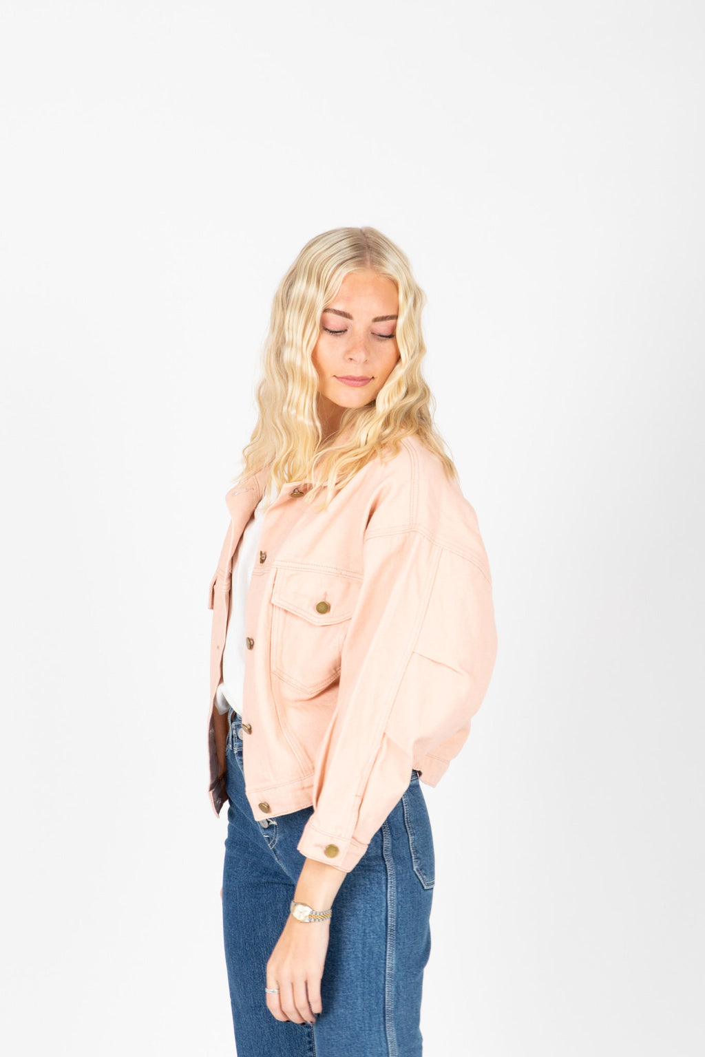 The Mitte Cropped Denim Jacket in Blush, studio shoot; side view