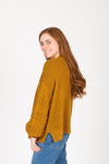 The Clarise Open Pocket Cardigan in Mustard, studio shoot; side view