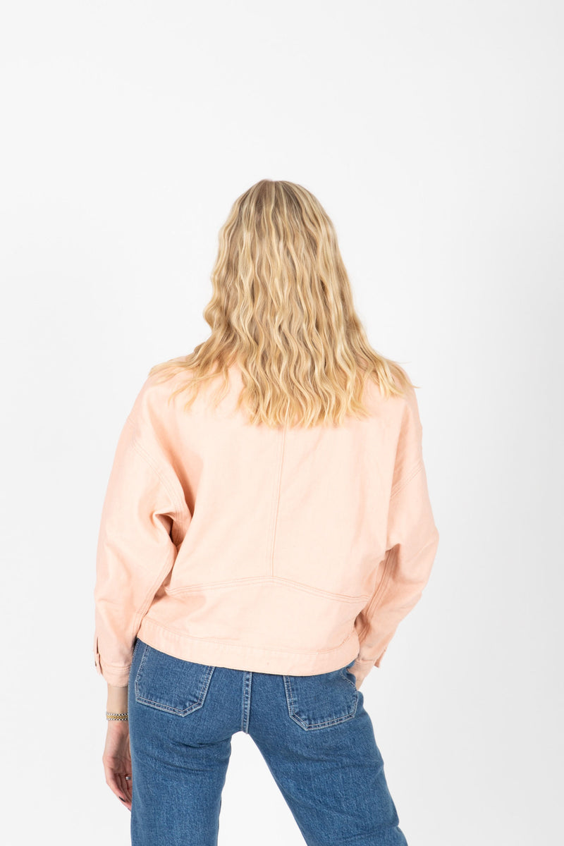 The Mitte Cropped Denim Jacket in Blush, studio shoot; back view