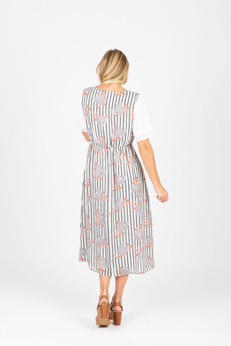 Piper & Scoot: The Escape Striped Floral Dress in Light Grey, studio shoot; back view