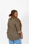 The Punch Embroidered Empire Blouse in Olive, studio shoot; back view